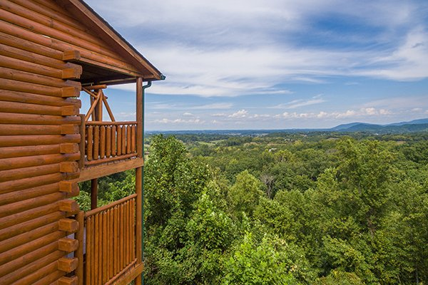 Treetops and cabin exterior at Shangri-lodge, an 8 bedroom cabin rental located in Pigeon Forge