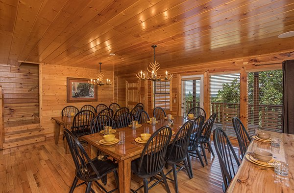 Dining space for 20, breakfast bar for 2 at Shangri-lodge, an 8 bedroom cabin rental located in Pigeon Forge