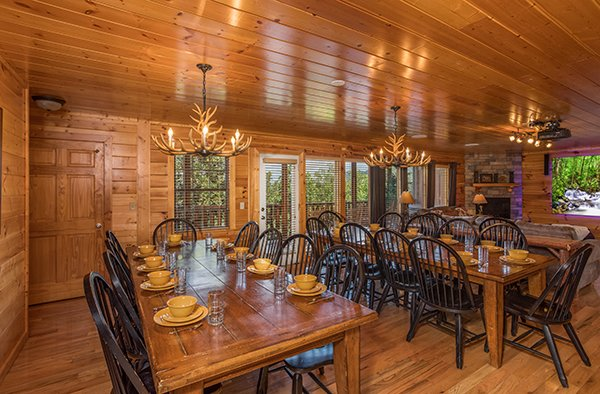 Dining space for 20 at Shangri-lodge, an 8 bedroom cabin rental located in Pigeon Forge