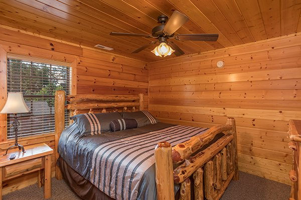 Bedroom with king log bed at Shangri-lodge, an 8 bedroom cabin rental located in Pigeon Forge