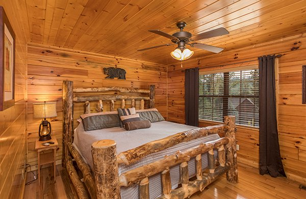 Bedroom with a log bed at Shangri-lodge, an 8 bedroom cabin rental located in Pigeon Forge