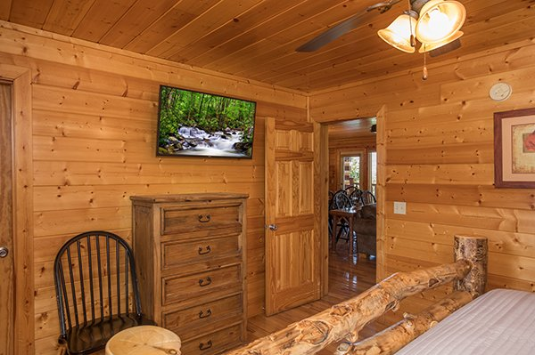 Dresser and TV in a bedroom at Shangri-lodge, an 8 bedroom cabin rental located in Pigeon Forge