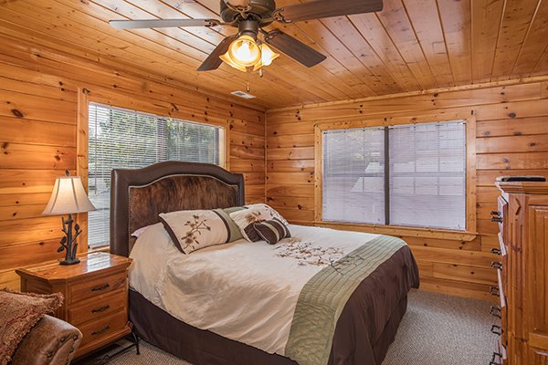 Bedroom with a queen bed and dresser at Shangri-lodge, an 8 bedroom cabin rental located in Pigeon Forge