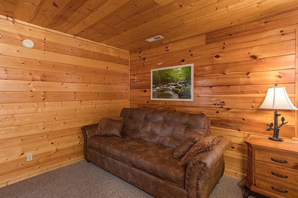 Sleeper sofa in a bedroom at Shangri-lodge, an 8 bedroom cabin rental located in Pigeon Forge