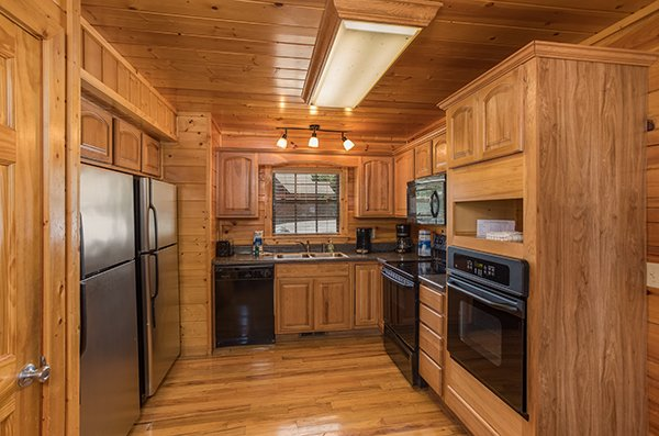 Kitchen with two refridgerators at Shangri-lodge, an 8 bedroom cabin rental located in Pigeon Forge