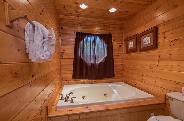 Jacuzzi in the common bath on the main floor at Shangri-lodge, an 8 bedroom cabin rental located in Pigeon Forge