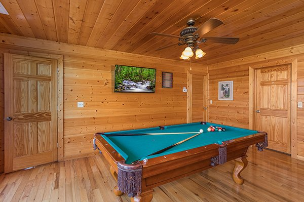 Pool table in the game room at Shangri-lodge, an 8 bedroom cabin rental located in Pigeon Forge