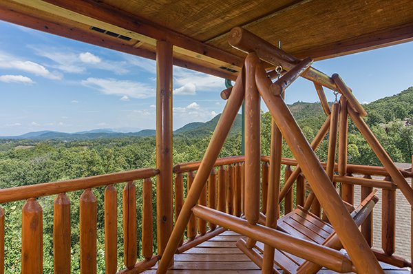 Swing on a covered deck with mountain views at Shangri-lodge, an 8 bedroom cabin rental located in Pigeon Forge