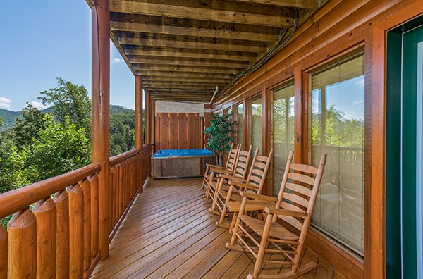 Rocking chairs overlooking the view at Shangri-lodge, an 8 bedroom cabin rental located in Pigeon Forge