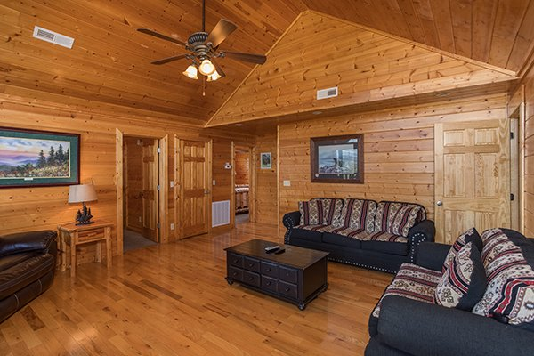 Sofabed and love seat in the living room at Shangri-lodge, an 8 bedroom cabin rental located in Pigeon Forge
