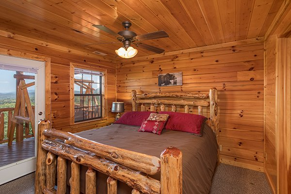 Bedroom with deck access at Shangri-lodge, an 8 bedroom cabin rental located in Pigeon Forge