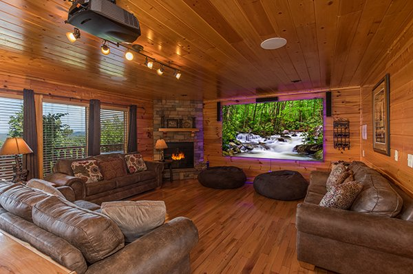 Theater room with a 10 foot screen at Shangri-lodge, an 8 bedroom cabin rental located in Pigeon Forge
