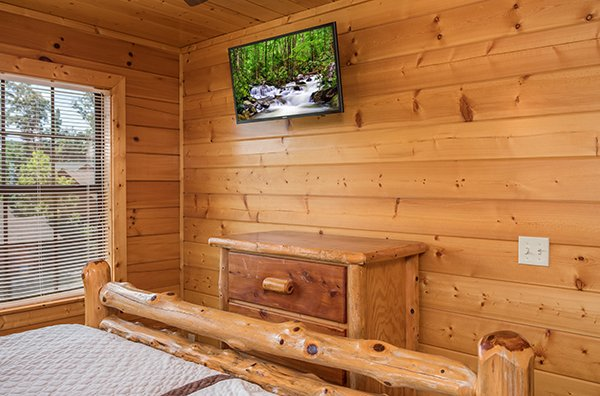 Bedroom with a dresser and TV at Shangri-lodge, an 8 bedroom cabin rental located in Pigeon Forge