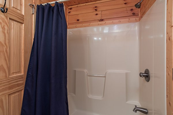 Bathroom with a tub and shower at Shangri-lodge, an 8 bedroom cabin rental located in Pigeon Forge