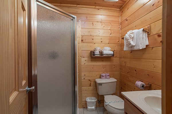 Bathroom with a walk in shower at Shangri-lodge, an 8 bedroom cabin rental located in Pigeon Forge