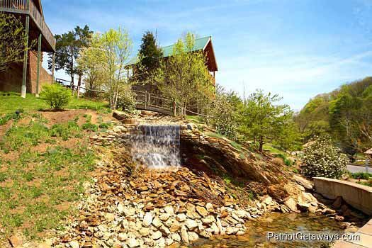 Water feature at the Alpine Mountain Village can be enjoyed by guests at Mountain Music, a 5 bedroom cabin rental located in Pigeon Forge