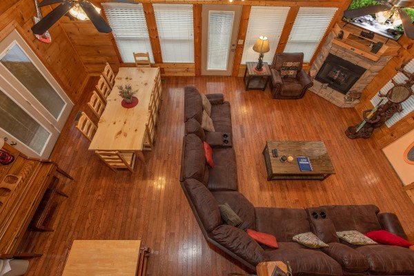 Looking down on the dining and living spaces from upstairs at Mountain Music, a 5 bedroom cabin rental located in Pigeon Forge