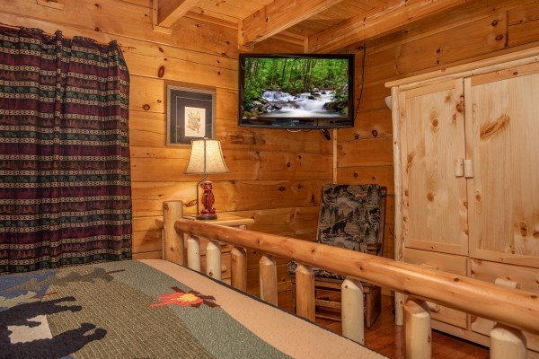 Armoire and TV in a bedroom at Mountain Music, a 5 bedroom cabin rental located in Pigeon Forge