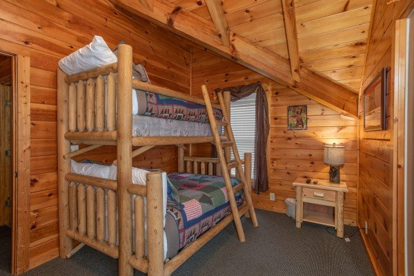 Bedroom with a full and twin bunk bed at Mountain Music, a 5 bedroom cabin rental located in Pigeon Forge