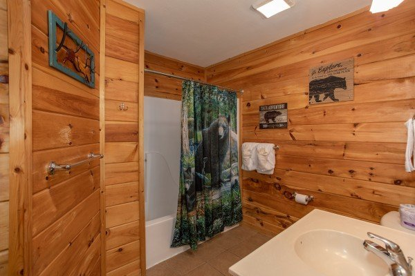 Bathroom with a tub and shower at Mountain Music, a 5 bedroom cabin rental located in Pigeon Forge