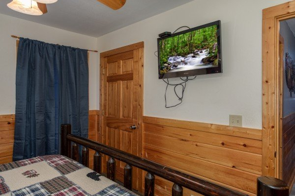 TV in a bedroom at Mountain Music, a 5 bedroom cabin rental located in Pigeon Forge