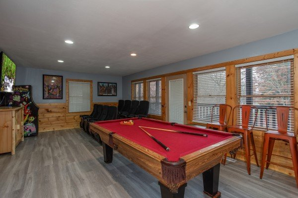 Pool table in the game room at Mountain Music, a 5 bedroom cabin rental located in Pigeon Forge