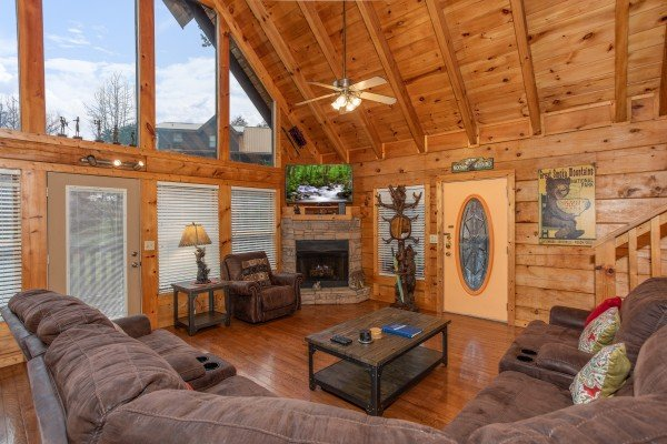 Living room with fireplace, TV, and vaulted ceiling at Mountain Music, a 5 bedroom cabin rental located in Pigeon Forge