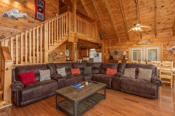 Sectional sofa in the living room at Mountain Music, a 5 bedroom cabin rental located in Pigeon Forge