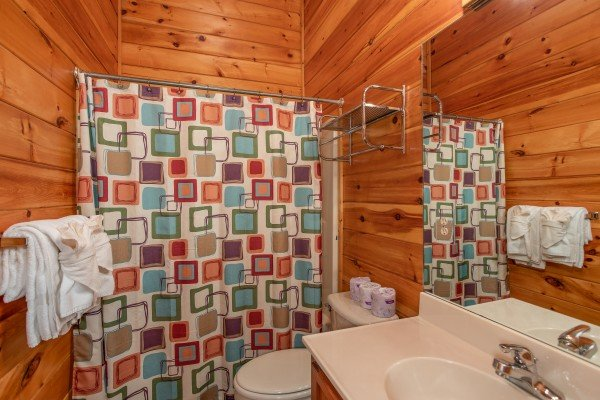 Bathroom with a tub and shower in the loft at Mountain Music, a 5 bedroom cabin rental located in Pigeon Forge