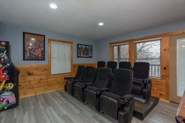 Theater room seats in the game room at Mountain Music, a 5 bedroom cabin rental located in Pigeon Forge