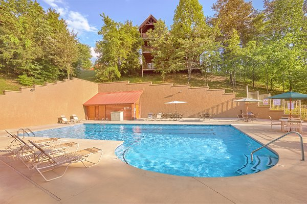 Outdoor pool access for guests at Granny D's, a 2 bedroom cabin rental located in Pigeon Forge