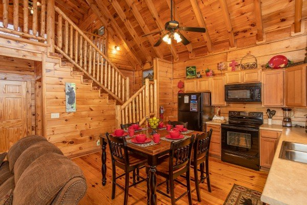 Dining space for six in the kitchen at Granny D's, a 2 bedroom cabin rental located in Pigeon Forge