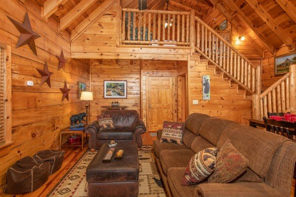 Living room with sofa, chair, and two bean bag chairs at Granny D's, a 2 bedroom cabin rental located in Pigeon Forge