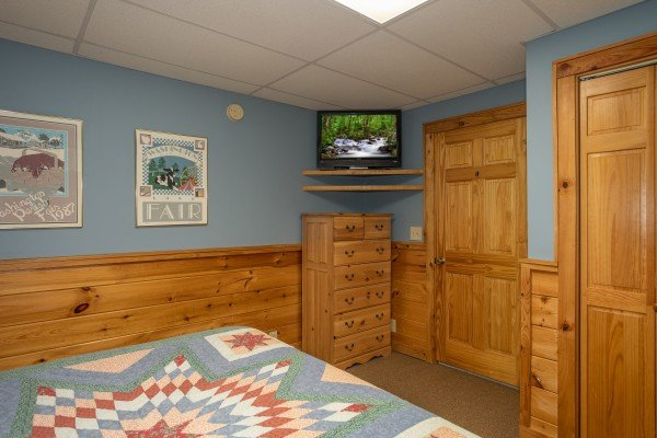 Dresser and TV in the lower floor bedroom at Granny D's, a 2 bedroom cabin rental located in Pigeon Forge