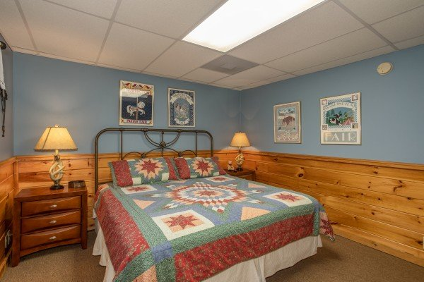 Bedroom on the lower level at Granny D's, a 2 bedroom cabin rental located in Pigeon Forge