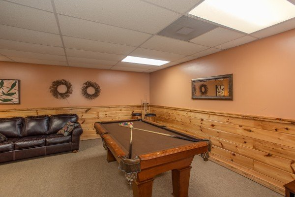 Pool table in the game room at Granny D's, a 2 bedroom cabin rental located in Pigeon Forge