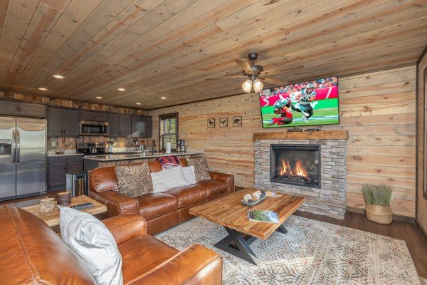 Living room with fireplace & TV at Heaven's Hill, a 3 bedroom cabin rental located in Gatlinburg