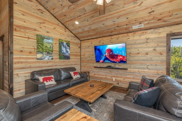 Loft with TV and seating at Heaven's Hill, a 3 bedroom cabin rental located in Gatlinburg