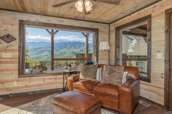 Leather loveseat and a view at Heaven's Hill, a 3 bedroom cabin rental located in Gatlinburg