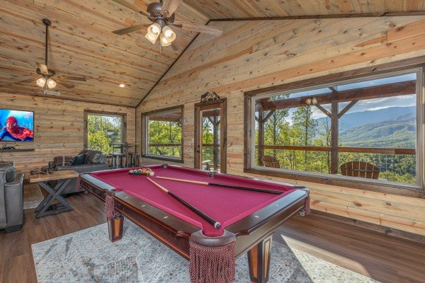 Red felt pool table in the loft at Heaven's Hill, a 3 bedroom cabin rental located in Gatlinburg