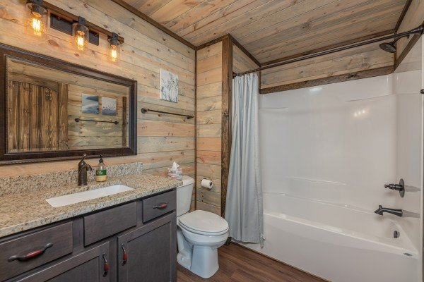 Bathroom with a tub and shower at Heaven's Hill, a 3 bedroom cabin rental located in Gatlinburg