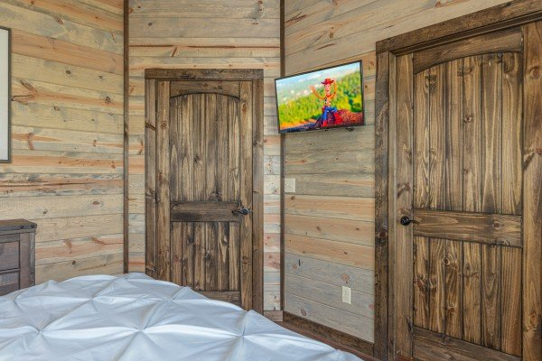 TV in a bedroom at Heaven's Hill, a 3 bedroom cabin rental located in Gatlinburg