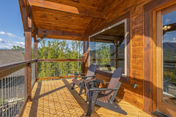 Adirondack chairs on the upper deck at Heaven's Hill, a 3 bedroom cabin rental located in Gatlinburg