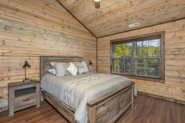 Lofted bedroom with two night stands and lamps at Heaven's Hill, a 3 bedroom cabin rental located in Gatlinburg