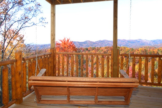 Deck with porch swing at Moose Mountain Lodge, a 4 bedroom cabin rental located in Gatlinburg
