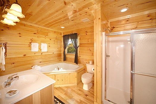 en suite bath with jacuzzi tub at moose mountain lodge a 4 bedroom cabin rental located in gatlinburg