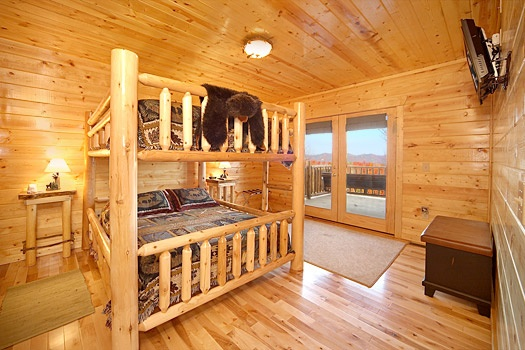 First floor bedroom with queen bunk bed at Moose Mountain Lodge, a 4 bedroom cabin rental located in Gatlinburg