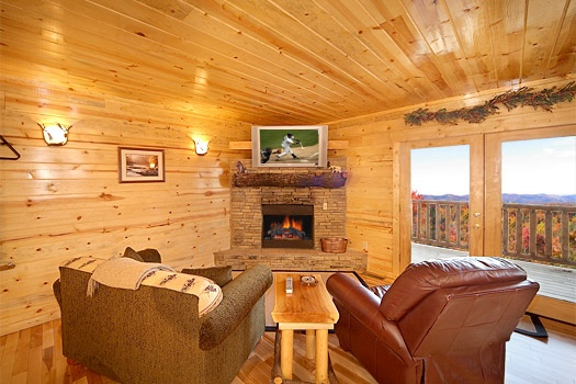 First floor game room with fireplace at Moose Mountain Lodge, a 4 bedroom cabin rental located in Gatlinburg