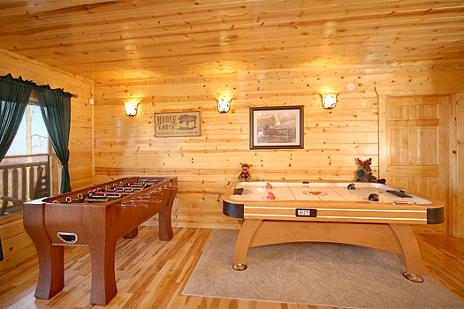 foosball and air hockey table in game room at moose mountain lodge a 4 bedroom cabin rental located in gatlinburg