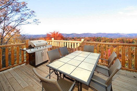 Grill and patio table at Moose Mountain Lodge, a 4 bedroom cabin rental located in Gatlinburg